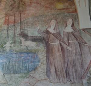 Santa Clara e sua irmã Santa Inês, seguidoras do crucificado.