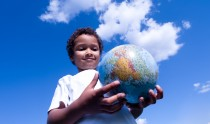 Cosmopolitan child holds the world in his hands