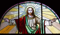 Stained glass window from 1854 of Jesus Christ with his arms outstretched, artist unknown, Czech Republic, full frame horizontal composition, copy space
