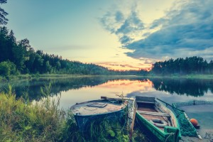 Two fishing boats on a small lake at dawn