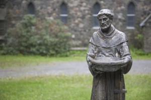 """""""Statue of St. Francis of Assisi outside Gloria Dei Episcopal Church, built from 1879 to 1885 in Palenville, in upstate New York. He's holding a dish with a bird perched on it. St. Francis is the patron saint for animals, charged with protecting them and the environment."""""""