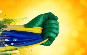 Hands painted in Brazilian colors.